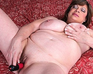 Horny American housewife playing with her toy and her big tits