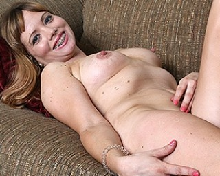 American housewife playing with herself on the couch