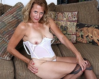 Naughty American secretary playing with her pussy