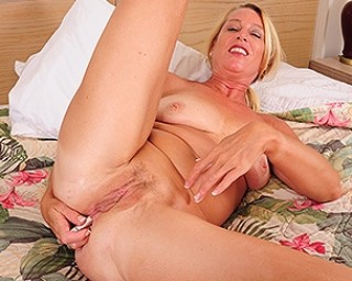 Naughty American housewife playing with herself at her hotelroom