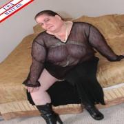 Chubby mature slut munching on a black cock