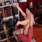 Shaved American housewife playing with her pussy