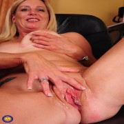 Naughty American housewife feeling up her pussy