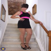 Naughty American Gina masturbating on the staircase
