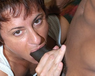 Mature female bodybuilder enjoying a black cock