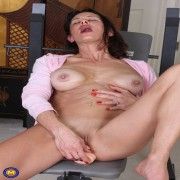 This naughty milf loves playing with herself