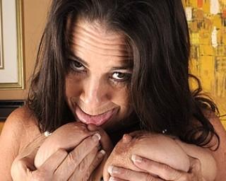 Naughty mature slut getting herself wet