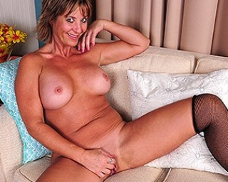 Naughty American housewife fingering her ass