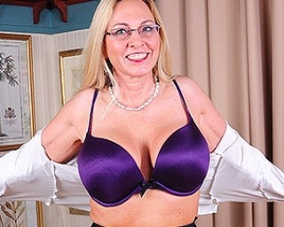 Big breasted American mom playing with her shaved pussy