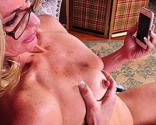 Naughty American housewife taking dirty selfies