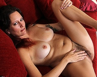 hairy American housewife playing with her bushy pussy