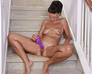 Naughty American lady masturbating on the stairs