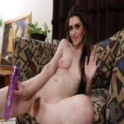hairy American housewife playing with her toys